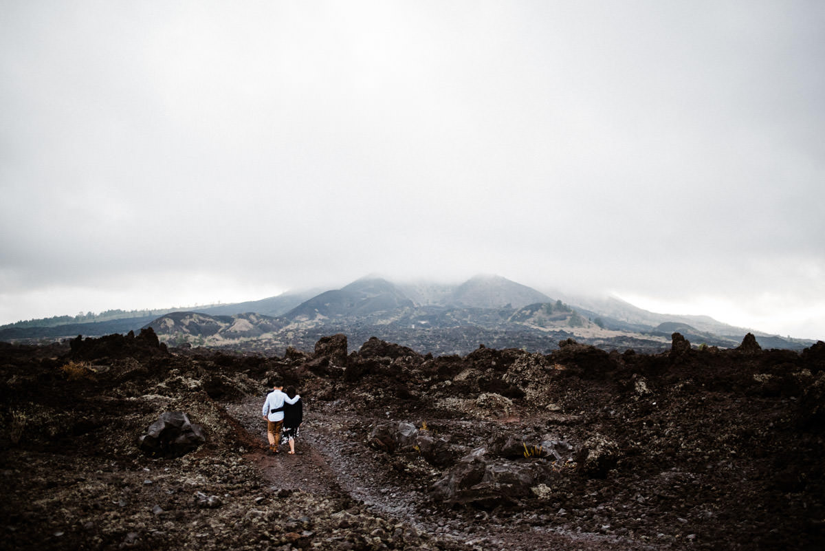 Pre wedding spot in Batur Mountain View with the couple walking in the black lava kintamani