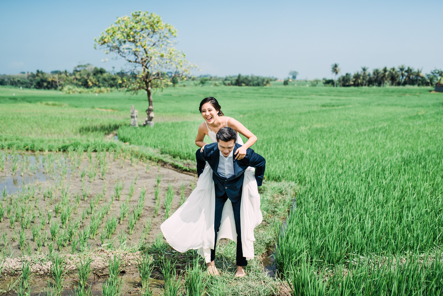 The couple were having fun in Seseh Rice Field during their engagement session