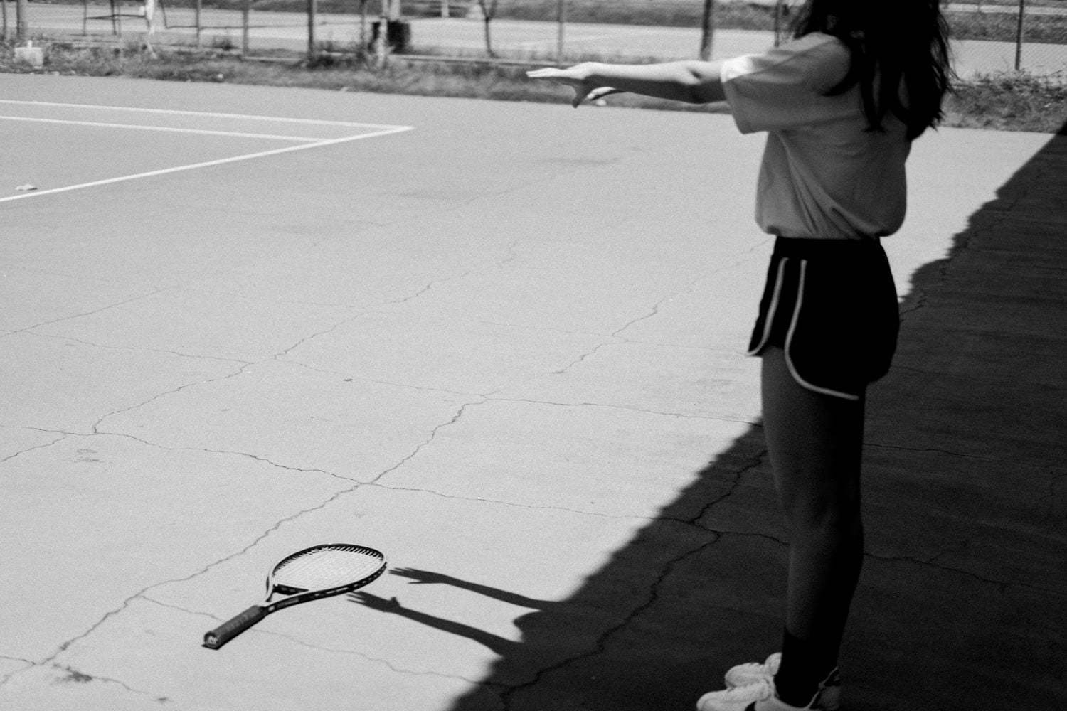The shadow play of Angel reaching the racket in Black and White