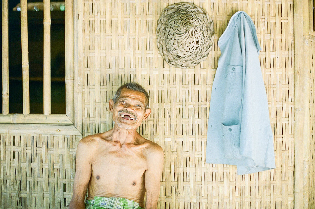 film photography of elderly smiling into the camera