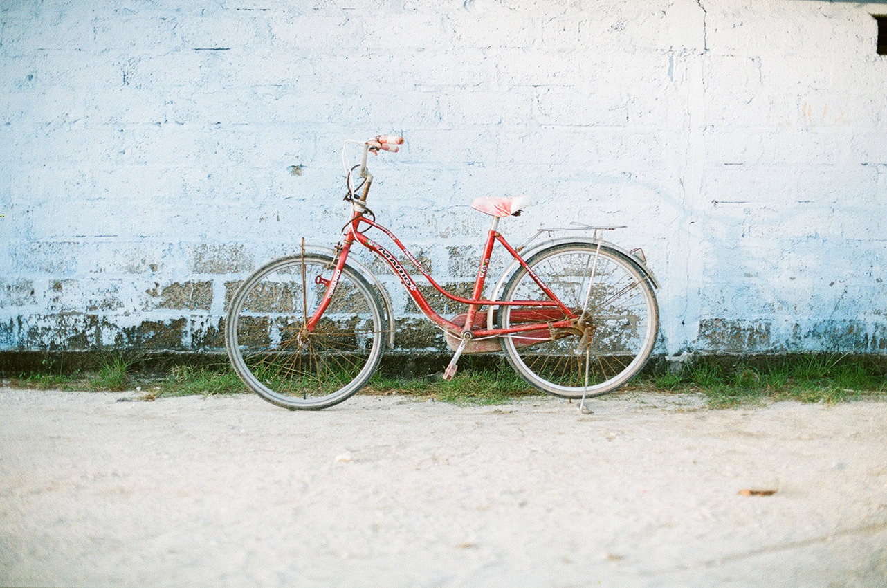 Bicycle over the blue wall.