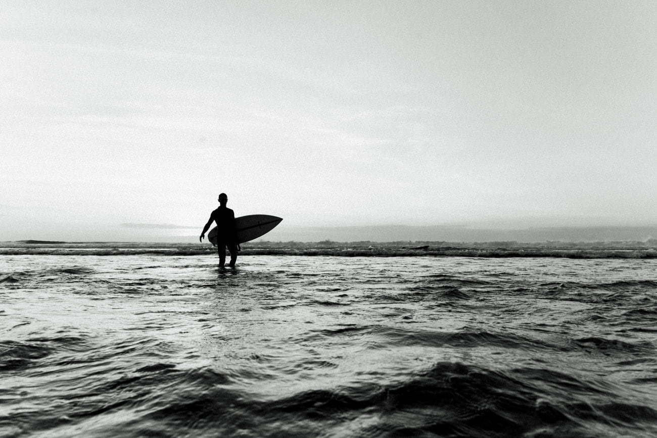 A surfer come back from surfing at Balangan Beach vibes
