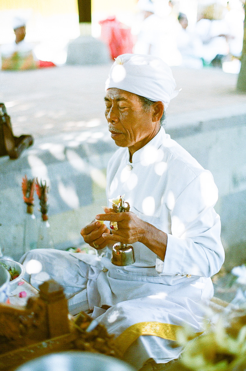 """""""Pemangku"""" is praying in the temple"""